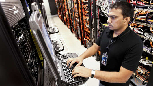 A senior lab systems engineer for Symantec Corp., works on network servers at the company's headquarters in Mountain View, California.