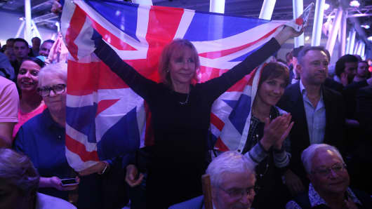 A Brexit supporter holds a Union flag.