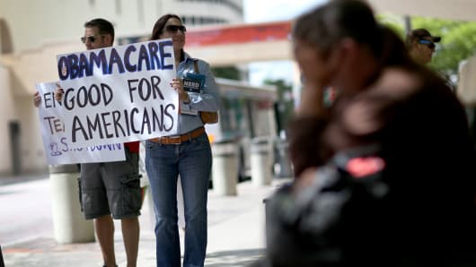 Supporters for the Affordable Care Act during a rally
