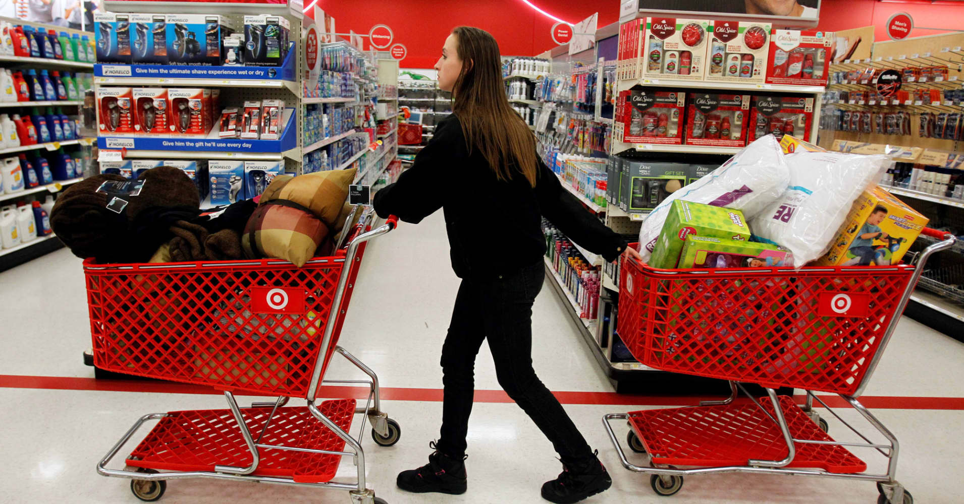 A woman pulls shopping carts through the aisle of a Target store in Torrington, Connecticut.