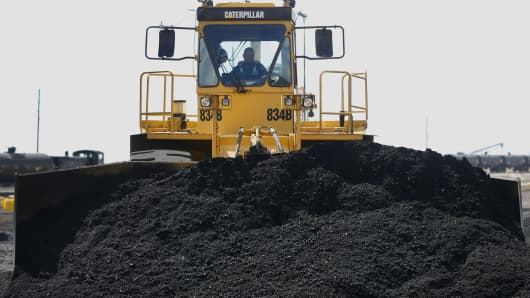 Coal piles are being transferred
