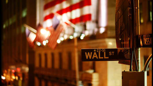 New York Stock Exchange (NYSE) and Wall Street at night