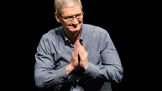 Tim Cook chief executive officer of Apple gestures during the Apple Worldwide Developers Conference in San Francisco