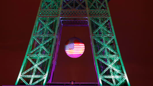 The American flag is projected on a giant soccer ball at the Eiffel Tower to pay a tribute for victims of a shooting inside a gay nightclub, Pulse Club in Orlando, Florida on June 13, 2016 in Paris, France.