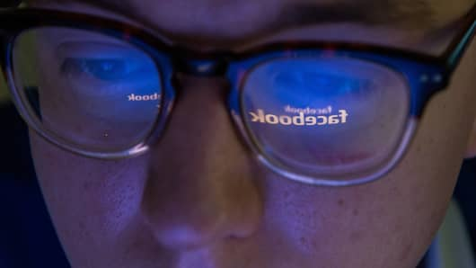 Facebook logo reflected in man's glasses on July 16, 2015 in Voronezh, Russia.