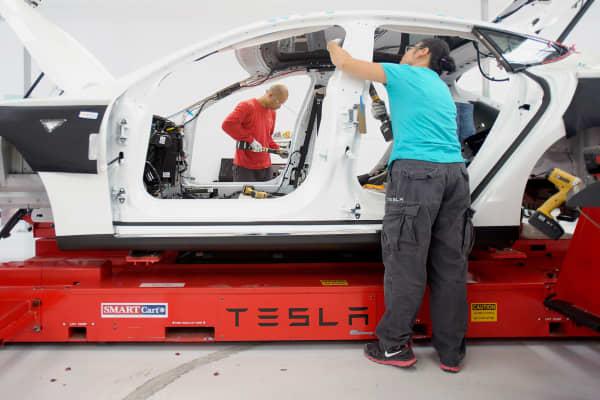 Telsa Motor Model S sedan workers