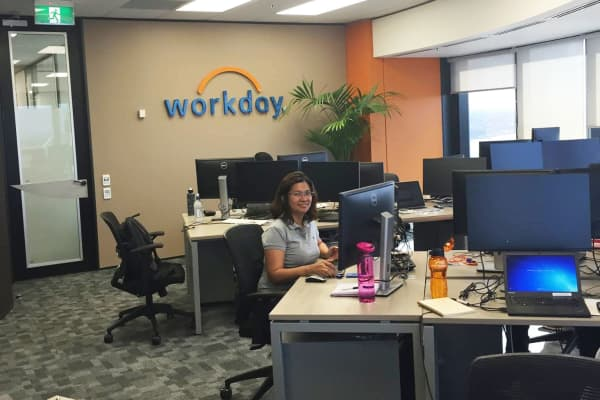 A workday employee poses for a photo in the headquarters located in Pleasanton, California