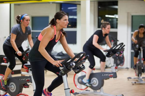 Women take a spin class at a gym on the Under Armour campus in Baltimore, Maryland