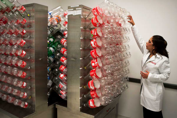 Bottles are stacked by a Coca Cola employee in the Mexico City, Mexico factory