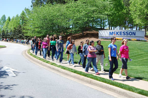 McKesson employees take a walk to the campus entrance