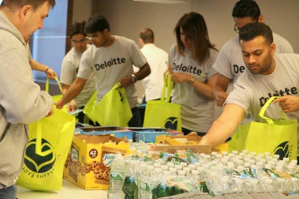 Deloitte employees perform community service