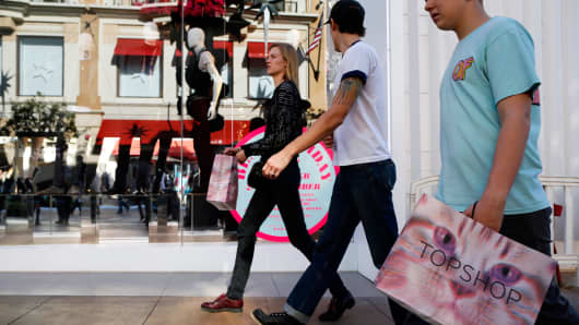 People shop at The Grove mall in Los Angeles.