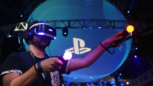 People try the new Sony VR headset at the Sony PlayStation E3 event at the Shrine Auditorium in Los Angeles, California, June 13, 2016.