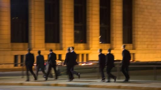 Group of businessmen, wall street, after hours