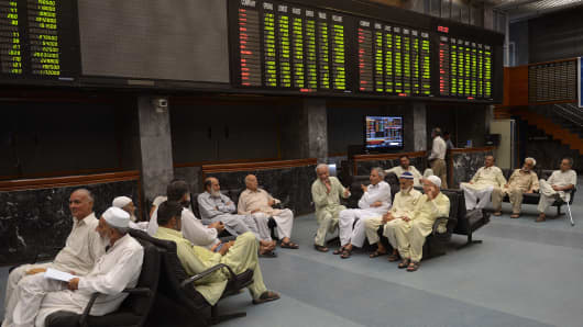 Pakistani stockbrokers during a trading session at the Karachi Stock Exchange (KSE).