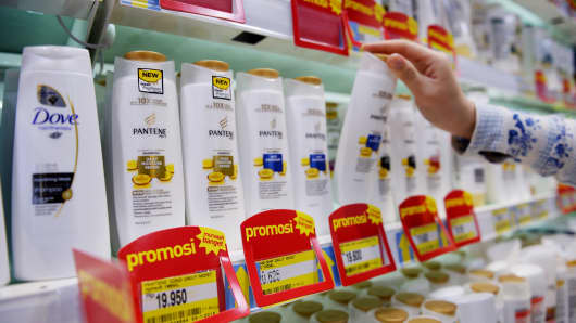 A customer selects a bottle of Procter & Gamble's Pantene shampoo at a Hypermart supermarket, operated by PT Matahari Putra Prima, in Karawaci, Banten, Indonesia.