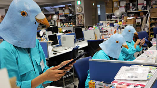Employees of Japanese toy company Tomy dressed as Twitter birds work at their desks during the company's Halloween Day event at the company headquarters in Tokyo on October 27, 2015.