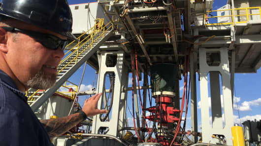 Rig supervisor David Crow shows off the oil rig he manages for Elevation Resources at the Permian Basin drilling site in Andrews County, Texas, May 16, 2016.