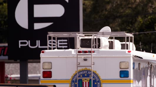 A vehicle belonging the Federal Bureau of Investigation (FBI) is parked at the crime scene at Pulse Nightclub on Orange Avenue, June 15, 2016 in Orlando, Florida.