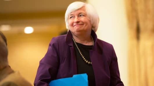 Fed expects inflation 'to move up' in 2018, signaling March rate hike