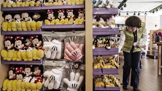 Mickey Mouse and Minnie Mouse plush toys are displayed for sale in a gift shop at the Toy Story Hotel at Walt Disney Co.'s Shanghai Disney Resort ahead of its official opening in Shanghai, China, on Tuesday, June 14, 2016.