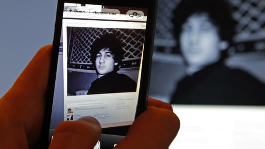 A photograph of Djohar Tsarnaev, who is believed to be Dzhokhar Tsarnaev, convicted in the Boston Marathon bombing, is seen on his page of Russian social networking site Vkontakte (VK), as pictured on a monitor and a mobile phone in St. Petersburg April 19, 2013. Tsarnaev posted links to Islamic websites and others calling for Chechen independence on what appears to be his page on the site.