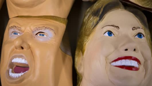 Rubber masks in the likeness of Republican presidential candidate Donald Trump, left, and Democratic presidential candidate Hillary Clinton