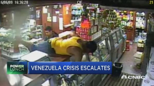 Venezuelans rioting as crisis escalates