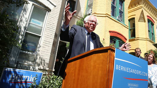 Democratic Presidential Candidate Bernie Sanders speaks to the media outside of his campaign headquarters June 14, 2016 in Washington, DC