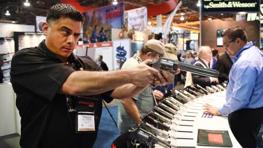 A man checks out a model S&W500 handgun at the Smith & Wesson booth during the 2016 National Shooting Sports Foundation's Shooting, Hunting, Outdoor Trade (SHOT) Show at the Sands Expo and Convention Center in Las Vegas, Nevada.