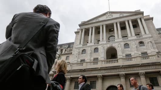 Pedestrians walk past the Bank of England (BOE) in the City of London, U.K.