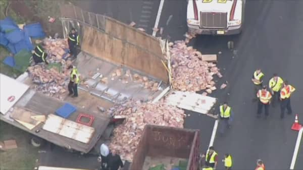 Deli meat truck collides with bread truck, creating messy commute