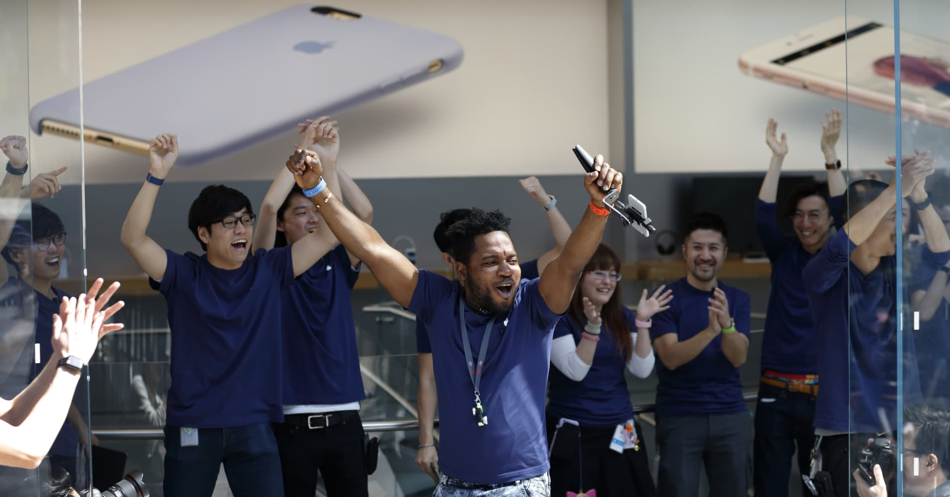Employees cheer before the launch of Apple Inc. iPhone SE and iPad Pro 9.7