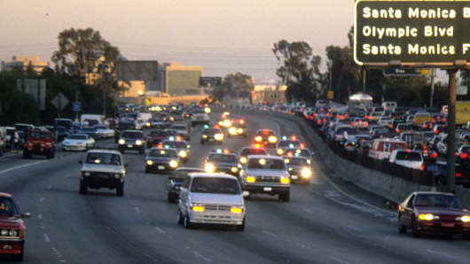 Police cars pursue the Ford Bronco driven by Al Cowlings, carrying fugitive murder suspect O.J. Simpson, on a 90-minute slow-speed car chase on June 17, 1994, on the 405 freeway in Los Angeles.