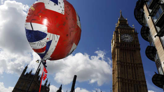 A Union Jack balloon outside the Houses of Parliament in London.