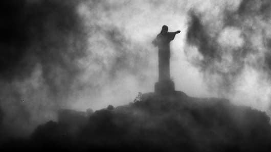 A general view of Christ the Redeemer, a statue of Jesus Christ, through the dark clouds during the Netherlands training session at the 2014 FIFA World Cup Brazil held at the Estadio Jose Bastos Padilha Gavea on June 19, 2014 in Rio de Janeiro, Brazil.