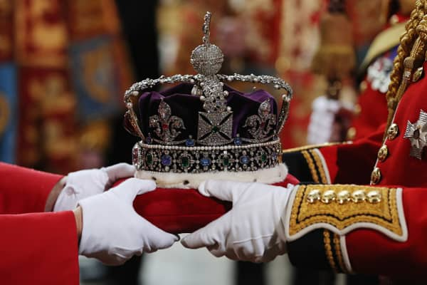 The Imperial State Crown is carried from the Houses of Parliament on May 18, 2016 in London, England.