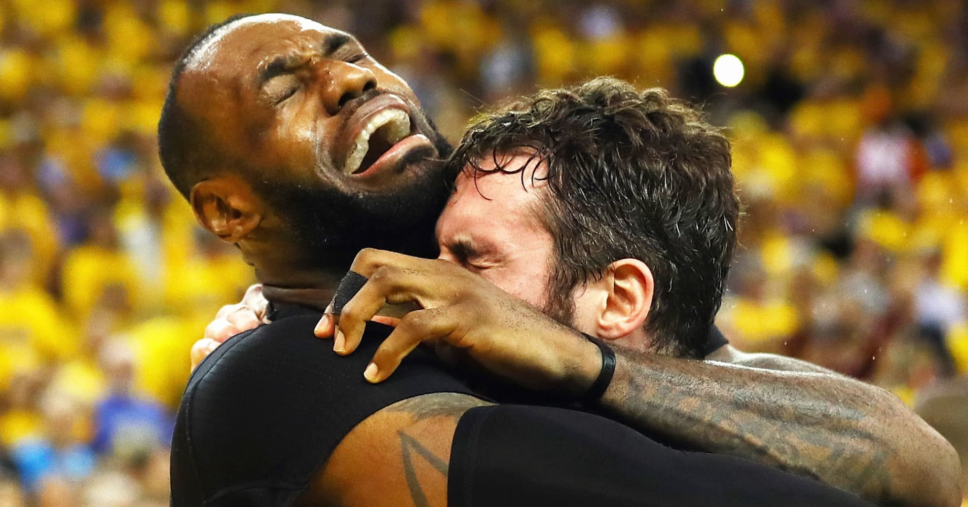 LeBron James and Kevin Love of the Cleveland Cavaliers celebrate after defeating the Golden State Warriors 93-89 in Game 7 of the 2016 NBA Finals at ORACLE Arena on June 19, 2016 in Oakland.