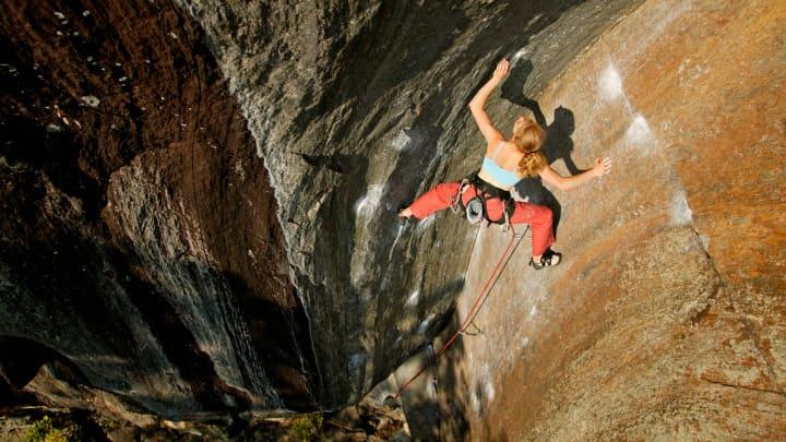 A woman rock climbing near Rumney, New Hampshire.