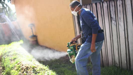 A Miami-Dade County mosquito control inspector uses a fogger to spray pesticide to kill mosquitos as the county continues to fight a possible Zika virus outbreak on May 26, 2016 in Miami.