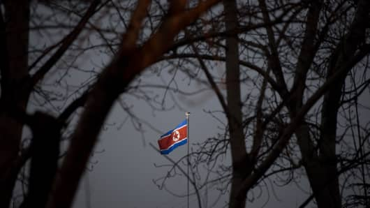 A North Korean flag flies above the North Korean embassy in Beijing on February 12, 2013. A North Korean diplomat who was part of the so-called six-party talks aimed at ending the country's nuclear program arrived on Monday in China, where she is expected to attend a forum in which the U.S. nuclear envoy will take part, Japan's Kyodo news agency said.
