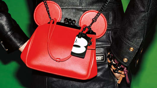 Coach collaborates with Disney with line of handbags and accessories.