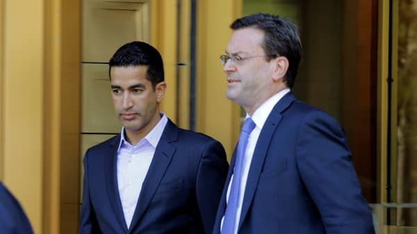 Sanjay Valvani (L) departs Federal Court after a hearing following his arrest in New York, U.S., June 15, 2016.