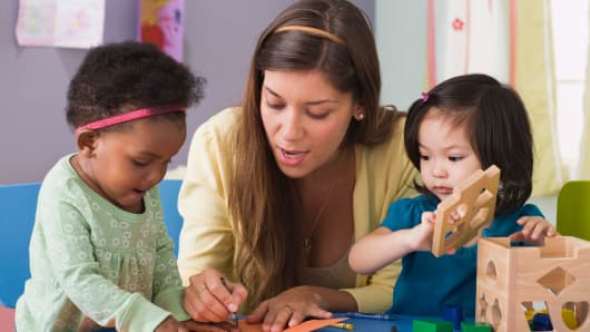 Child care worker and children