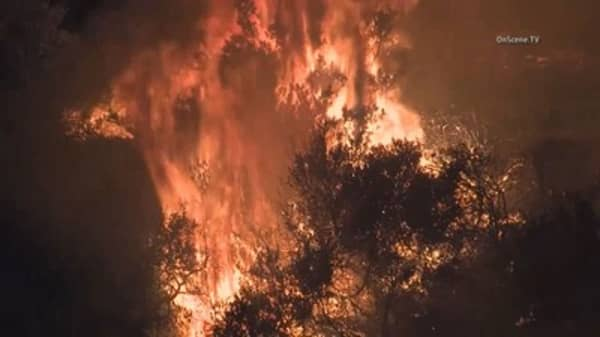 Deadly heat wave fueling Western wildfires