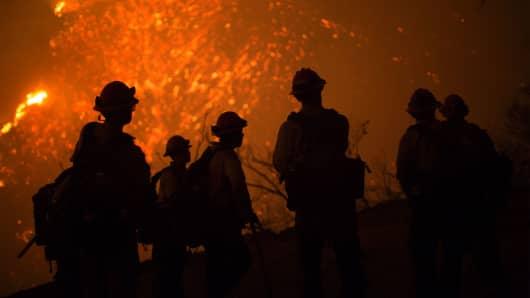 Firefighters battle an expanding wildfire, June 17, 2016 at the Sherpa Fire near Santa Barbara, California.