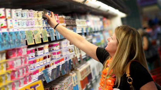 A customer shops for yogurt at a Trader Joe's store in Pinecrest, Florida.