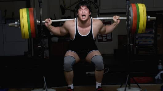 weight lifter struggling to lift