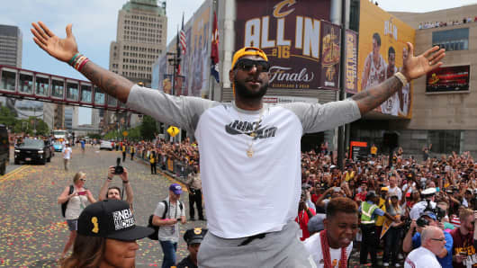 Cleveland Cavaliers Lebron James celebrates with the crowd during a parade to celebrate winning the 2016 NBA Championship in downtown Cleveland, Ohio, U.S. June 22, 2016.