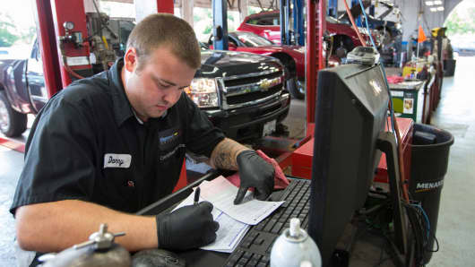 A technician works on paperwork at Raymond Chevrolet in Antioch, Illinois.